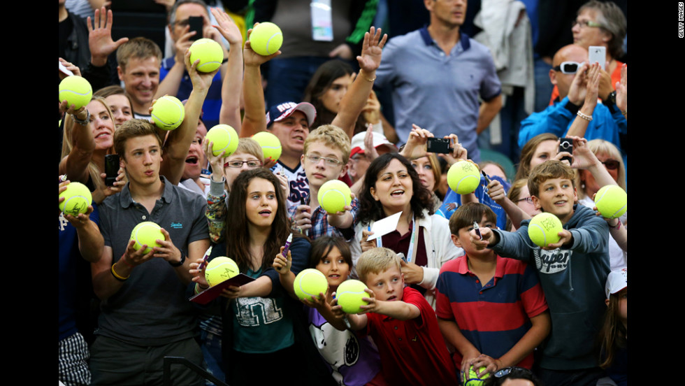 Tennis fans celebrate their favorite sport with a giveaway of Super Tennis Balls. Things didn't go over as well at the shot put field.