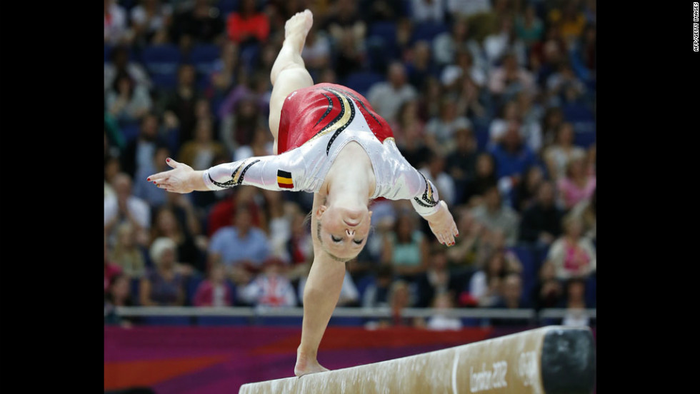 "Belgian gymnast Gaelle Mys competes on the balance beam during the women's artistic gymnastics qualification event. Check out photos from <a href=""http://www.cnn.com/2012/07/30/worldsport/gallery/olympics-day-three/"" target=""_blank"">Day 3 of the competition.</a>"