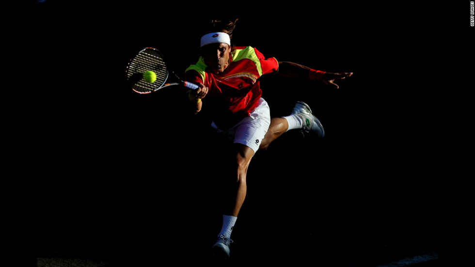 David Ferrer of Spain plays a forehand shot during the men's singles tennis match against Vasek Pospisil of Canada.