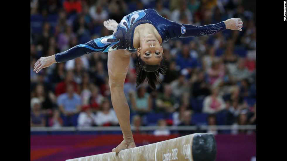Guatemalan gymnast Ana Sofia Gomez Porras competes on the balance beam during the women's artistic gymnastics qualification event.