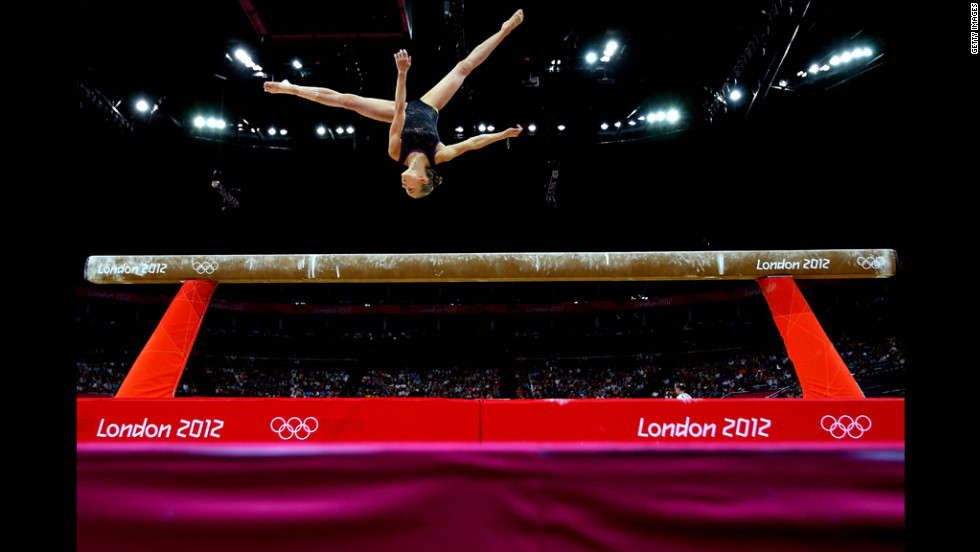 Laura Svilpaite of Lithuania competes on the beam during the artistic gymnastics women's team qualification round.