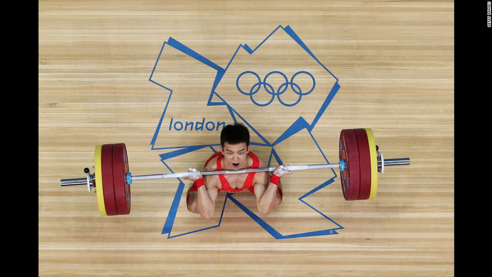 Jingbiao Wu of China takes part in the men's 56-kilogram weightlifting competition.