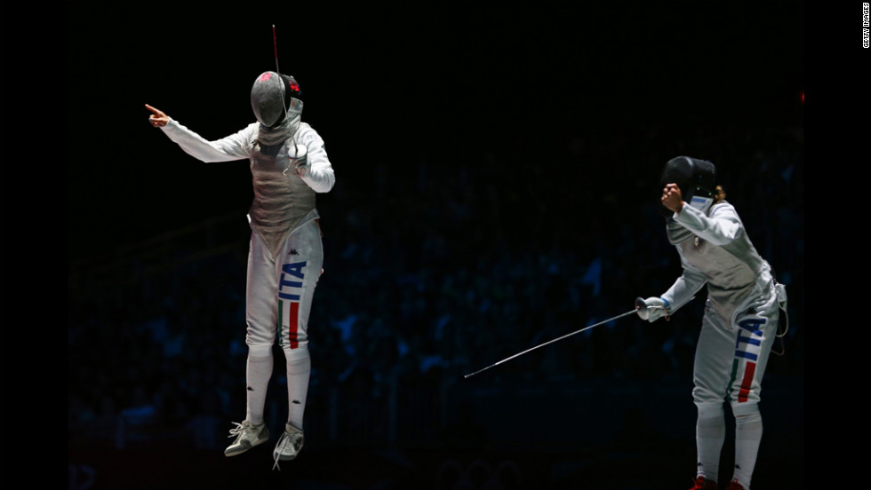 Arianna Errigo, left, of Italy celebrates winning her semifinal fencing match against Valentina Vezzali of Italy in women's individual foil.