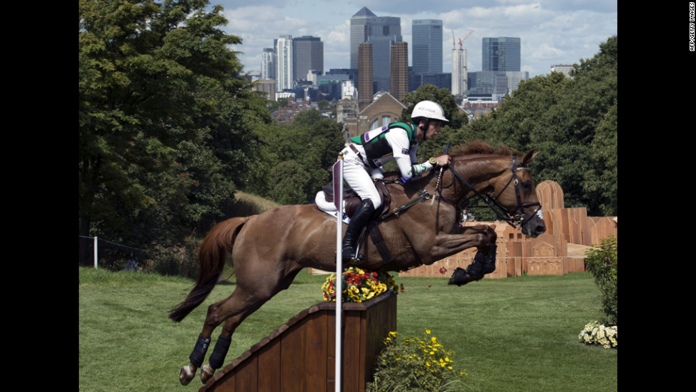 Australia's Chris Burton, riding HP Leilani, competes in the cross-country phase of the equestrian eventing competition in Greenwich Park, London, on Monday.
