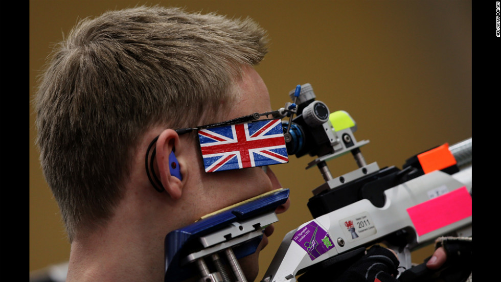 Britain's James Charles Huckle takes a shot during the men's 10-meter air rifle men final on Monday.