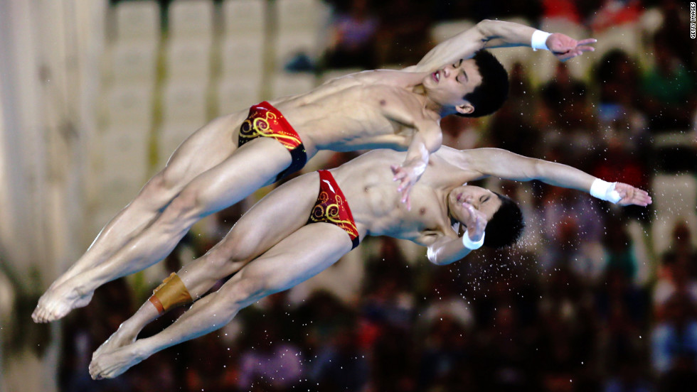 Yuan Cao and Yanquan Zhang of China compete in the men's synchronized 10-meter platform diving contest Monday.
