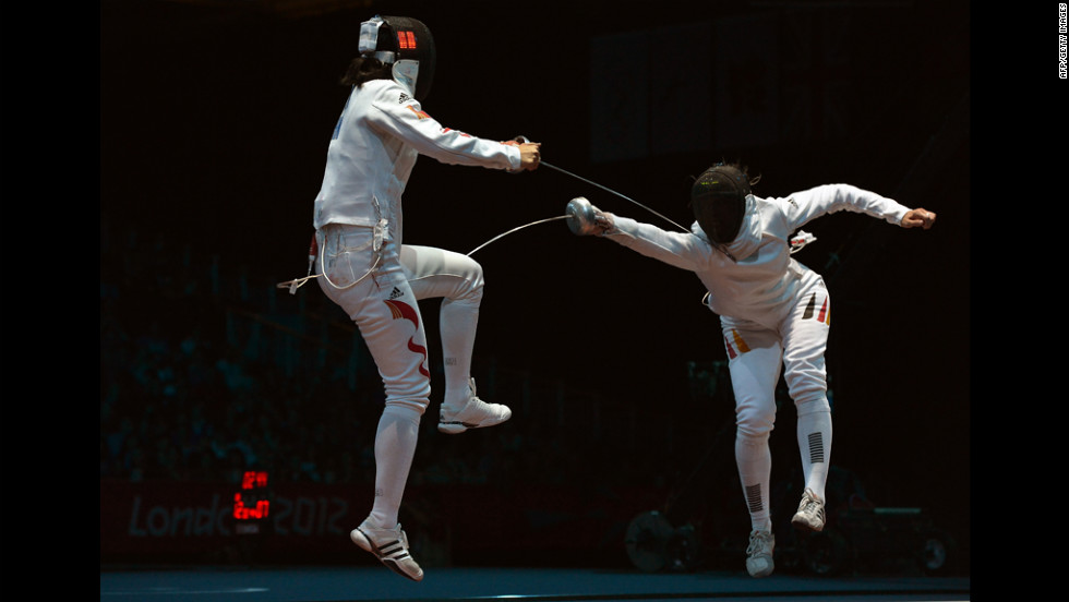 Germany's Britta Heidemann, right, takes on China's Li Na during the women's epee bout Monday.