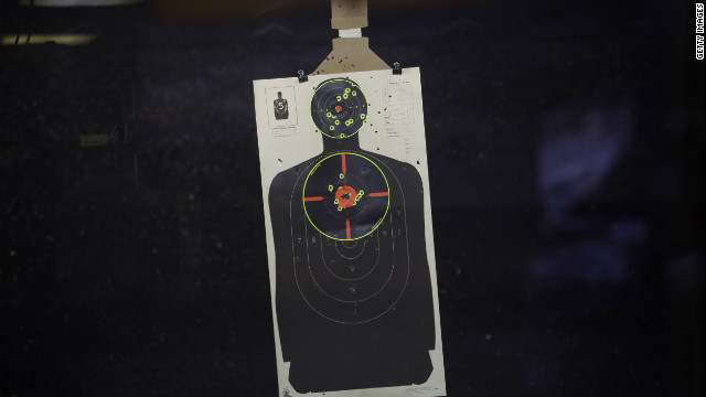 A target sheet hangs at a shooting range July 22 in Aurora, Colorado.