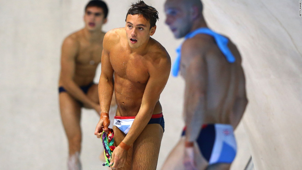 Tom Daley, center, of Great Britain watches from the pool deck during the men's synchronized 10-meter platform diving Monday.