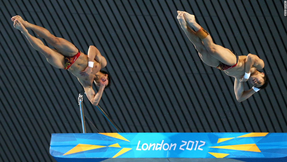 Yuan Cao and Yanquan Zhang of China soar in the men's synchronized 10-meter platform diving on Monday.