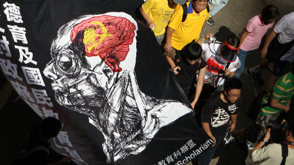 "Protester march against  implement national education in Hong Kong, claiming it amounts to Chinese patriotic ""brainwashing"