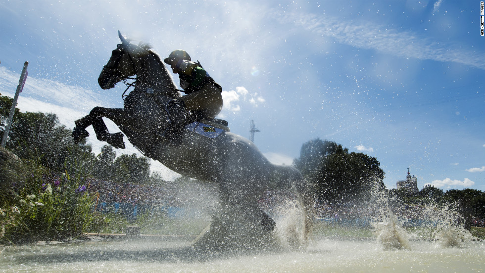 Jamaica's Samantha Albert, riding Carraig Dubh, competes in the cross country phase of the eventing competition.