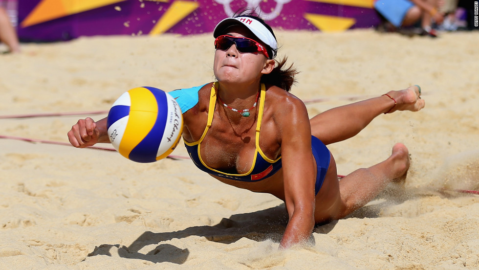 Chen Xue of China dives for a shot during a women's beach volleyball preliminary match against Switzerland on Monday, July 30.
