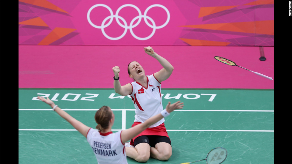 Kamilla Rytter Juhl, right, and Christinna Pedersen of Denmark celebrate after beating China's Yunlei Zhao and Qing Tian in a women's doubles badminton match Tuesday.