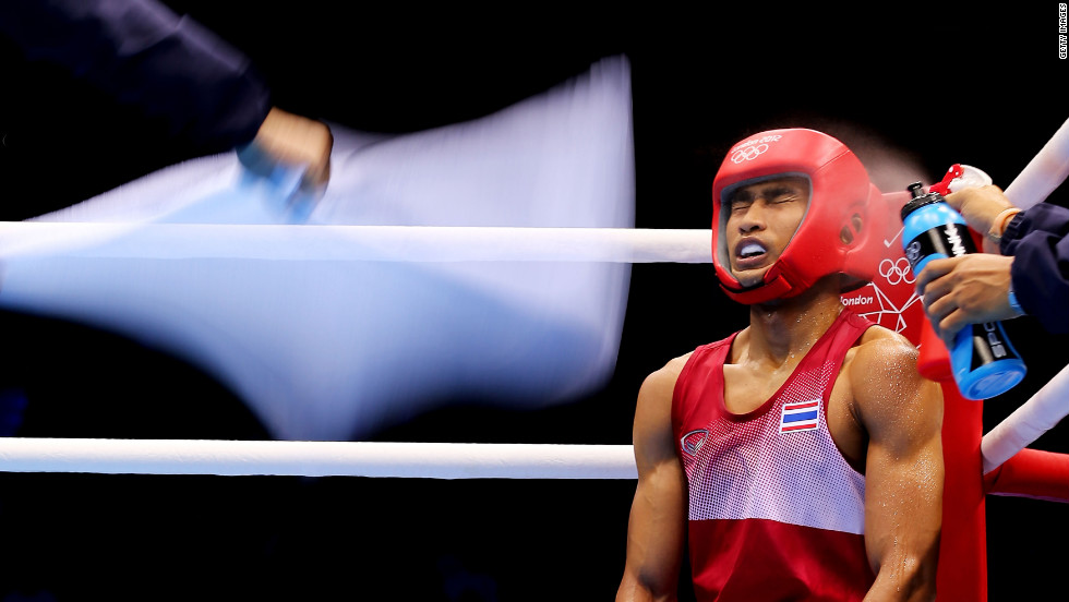 "Chatchai Butdee of Thailand sits in his corner during his men's fly boxing bout with Selcuk Eker of Turkey on Monday, July 30, on Day 3 of the London 2012 Olympic Games. <a href=""http://www.cnn.com/2012/07/29/worldsport/gallery/olympics-day-two/index.html"" target=""_blank"">Check out Day 2 </a>of competition from Sunday, July 29. The Games run through August 12. See all the action as it unfolds here."