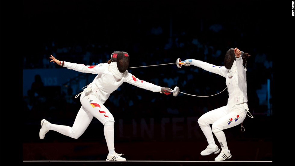 Yujie Sun (left) of China competes against A Lam Shin (right) of Korea during the bronze medal bout in the women's epee individual fencing.