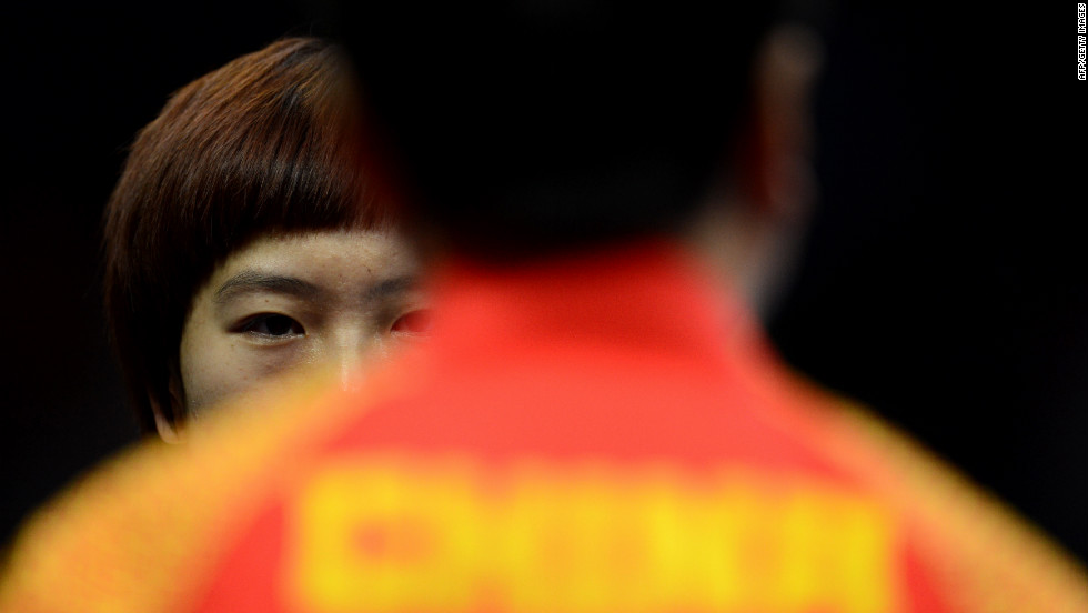 Li Xiaoxia of China talks with her coach during a table tennis women's quarterfinals match Tuesday.