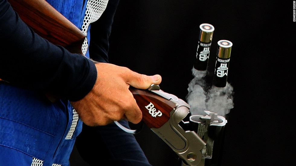 Italy's Ennio Falco removes cartridges as he competes in the men's skeet shooting qualification round Tuesday.
