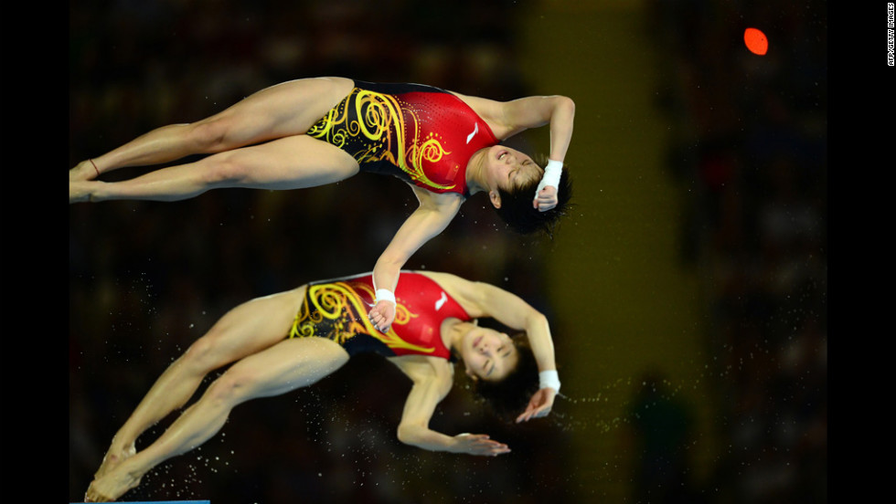 China's Chen Ruolin and Wang Hao compete in the women's synchronized 10-meter platform final. They won a gold for their performance.