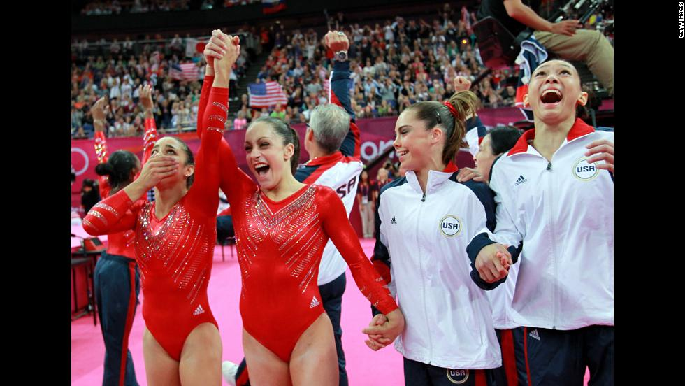 Alexandra Raisman, Jordyn Wieber, McKayla Maroney and Kyla Ross of the United States celebrate during the final rotation in the gymnastics women's team final.