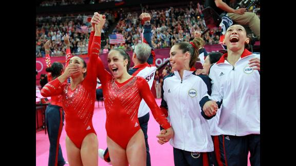 Alexandra Raisman, Jordyn Wieber, McKayla Maroney and Kyla Ross of the United States celebrate during the final rotation in the gymnastics women's team final.