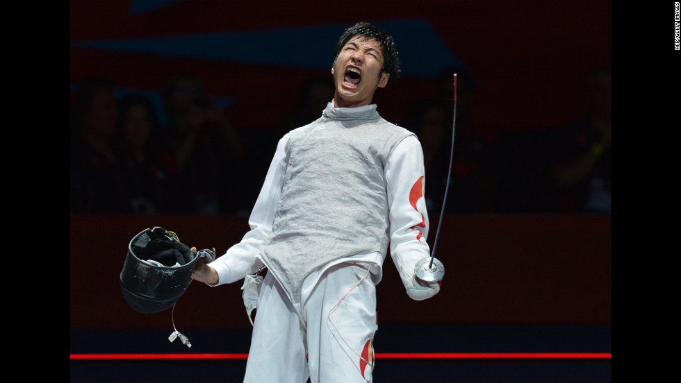 Chinese fencer Lei Sheng celebrates his victory over Italy's Andrea Baldini at the end of their men's foil semifinal bout.