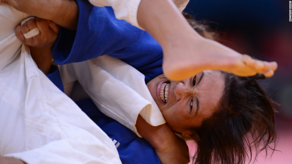 Turkmenistan's Gulnar Hayytbaeva, in blue, fights with Azerbaijan's Ramila Yusubova during the women's under 63-kilogram judo match Tuesday.