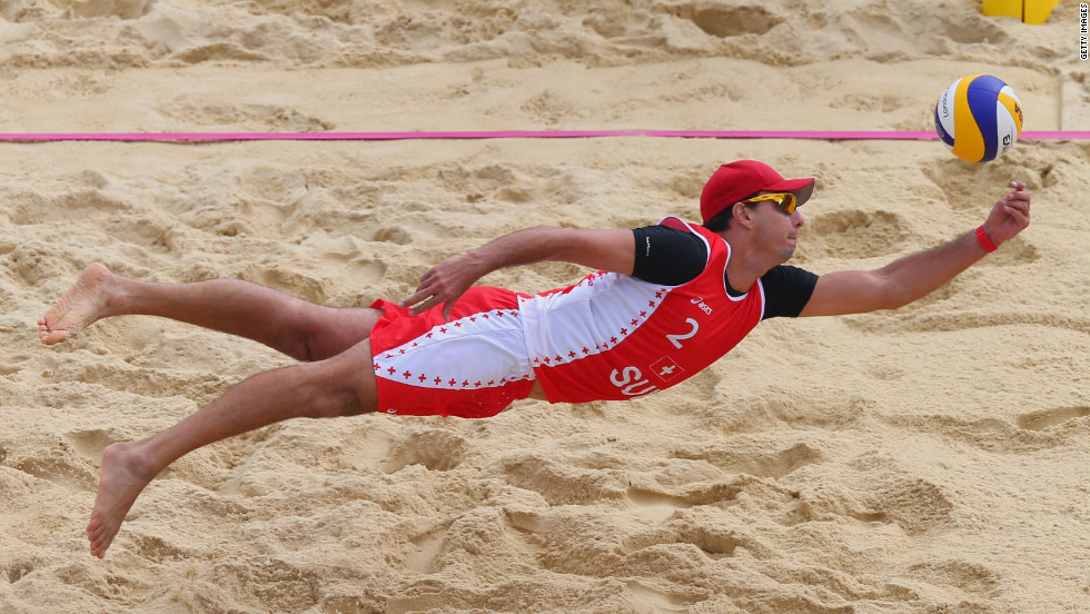 Jefferson Bellaguarda of Switzerland dives for a shot during the men's beach volleyball preliminary match between Brazil and Switzerland on Tuesday.