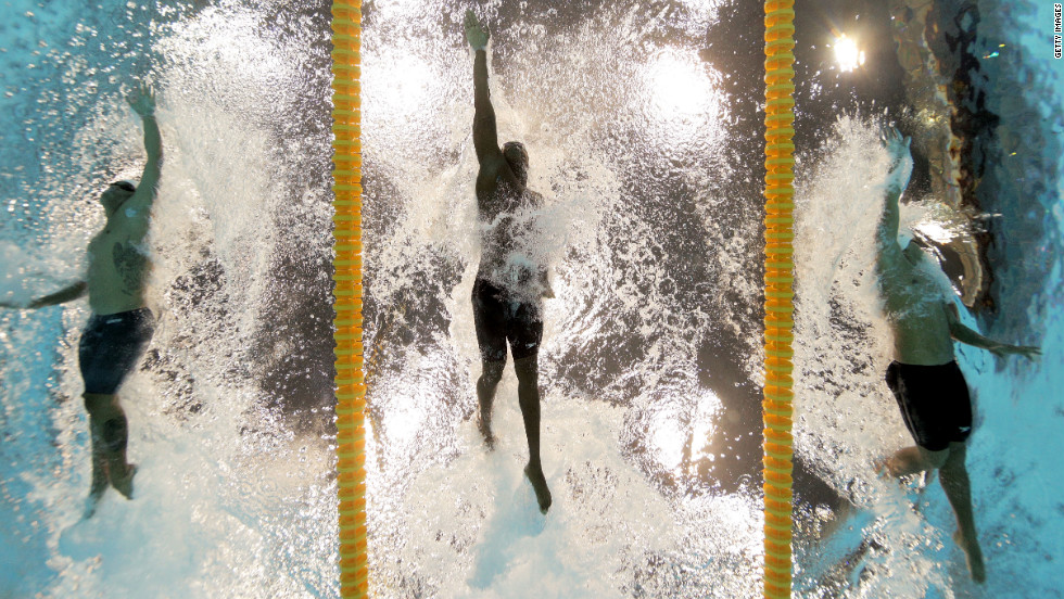 "From left, Ahmed Husam of the Maldives, Mamadou Soumare of Mali and Beni Bertrand Binobagira of Burundi compete in the men's 100-meter freestyle heat Tuesday. See photos from <a href=""http://www.cnn.com/2012/08/01/worldsport/gallery/olympics-day-five/index.html"" target=""_blank"">day five of the competition</a> from Wednesday, August 1."