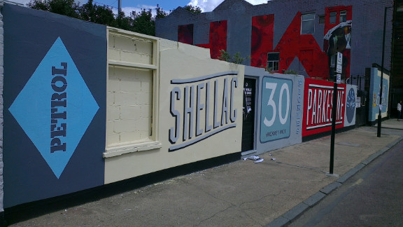 """These murals, called """"The Walls Have Ears,"""" were painted by Bread Collective, working with the community of Hackney Wick. The names in the murals were taken from the area"""