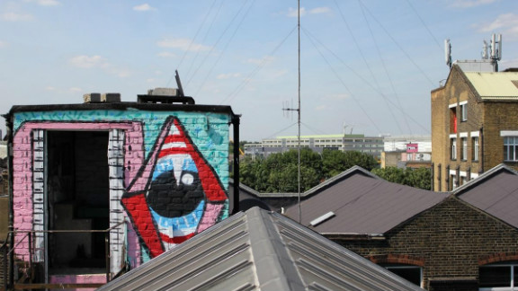 """Hackney Wick rooftops. Sweet Toof and Paul insect can be seen in the foreground.  Sweet Toof and Cylops in the distance. Paul Insect is most famous for his 2007 exhibition """"Bullion,"""" which was snapped up by Damien Hirst before it opened."""