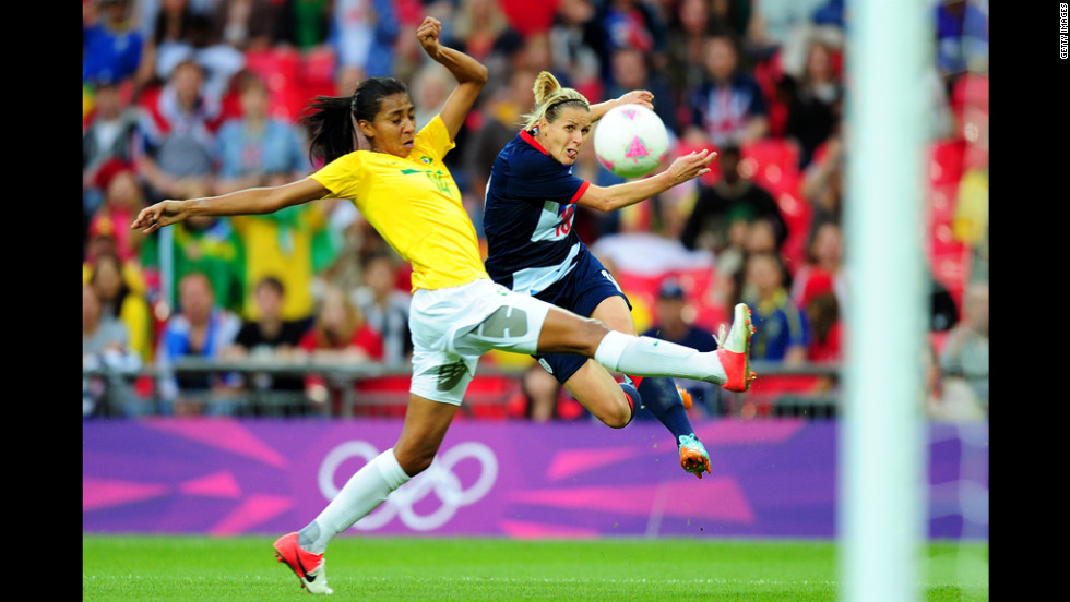 Kelly Smith of Great Britain shoots a goal under pressure from Bruna of Brazil during the women's first-round football match.