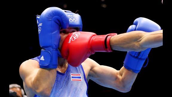 Kaeo Pongprayoon of Thailand boxes Mohamed Flissi of Algeria.