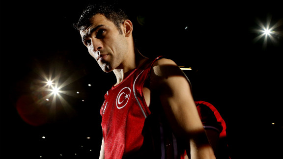 Ferhat Pehlivan of Turkey enters the ring before his boxing bout with Carlos Suarez of Trinidad and Tobago.