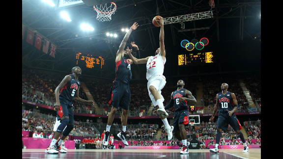 Makram Ben Romdhane of Tunisia dunks over Tyson Chandler of the United States during a preliminary match.