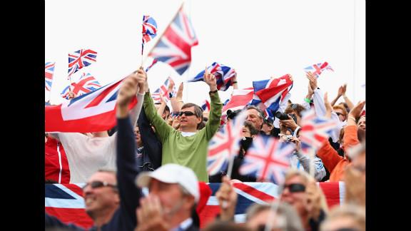 British fans wave Union Jacks as they enjoy the atmosphere at Eton Dorney.