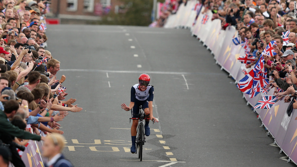 Elizabeth Armitstead of Great Britain waves to the crowds after the women's individual time trial road cycling race.