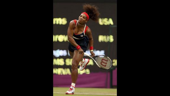 Serena Williams of the United States serves to Vera Zvonareva of Russia during the third round of women