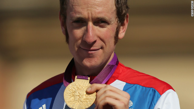 Wiggins makes history as Britain wins first golds at ...