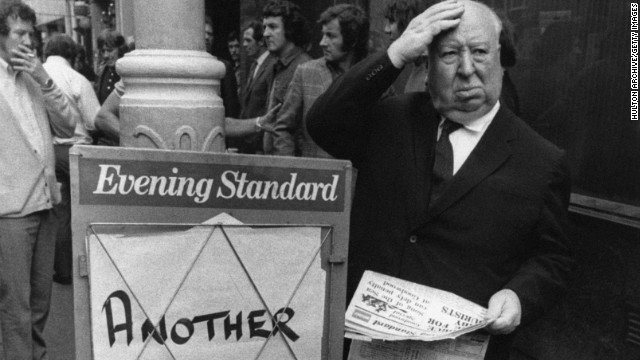 Alfred Hitchcock buys a copy of the Evening Standard with a chilling headline.