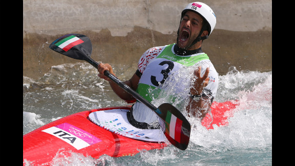 Daniele Molmenti of Italy celebrates winning the gold medal in the men