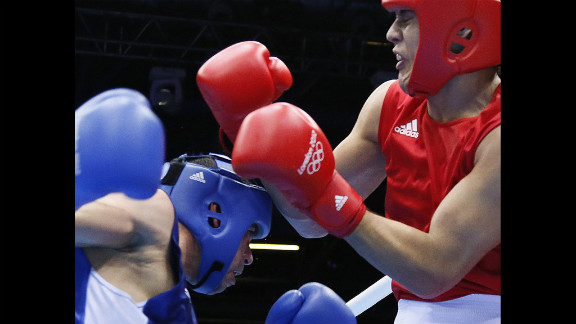 Yamil Peralta Jara of Argentina, right, defends against Chouaib Bouloudinats of Algeria during their heavyweight boxing match.