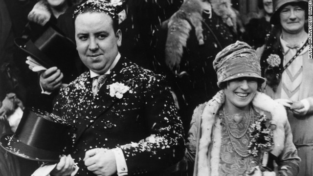 Alfred Hitchcock and Alma Reville are showered with confetti after their wedding.