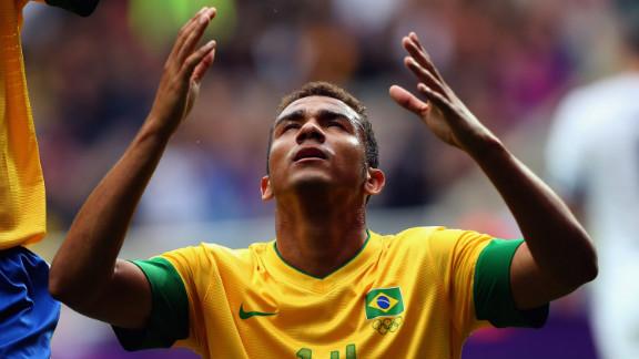 Danilo Luiz Da Silva of Brazil reacts after scoring against New Zealand during the first-round men