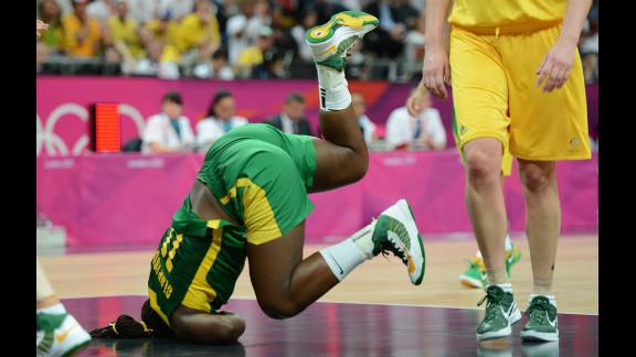 Brazilian center Clarissa Santos falls during the women