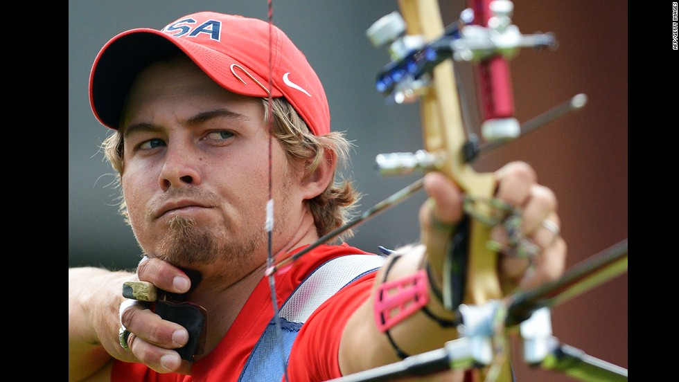 U.S. archer Brady Ellison competes against Mark Javier of the Philippines in the men's individual elimination match.