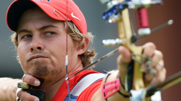 U.S. archer Brady Ellison competes against Mark Javier of the Philippines in the men