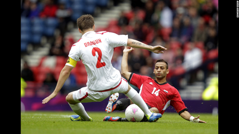 Egypt's Hossam Hassan, right, competes with Belarus' Stanislav Dragun during the men's soccer match in Glasgow, Scotland.