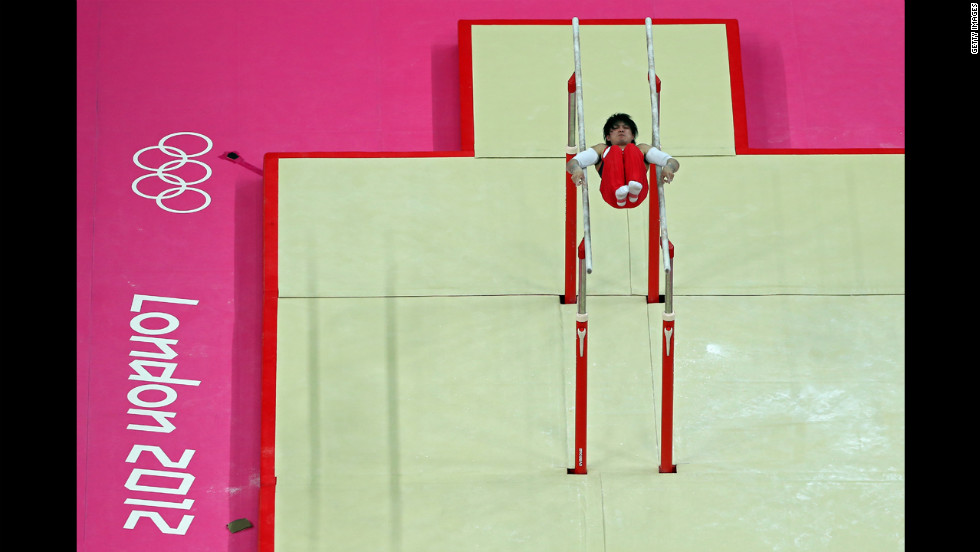 Kohei Uchimura of Japan competes on the parallel bars in the men's individual all-around gymnastics final.