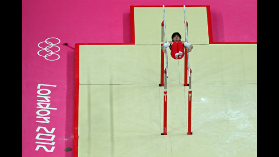 Kohei Uchimura of Japan competes on the parallel bars in the men